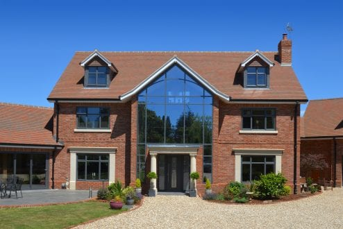 Modern self build with aluminium windows and curtain wall