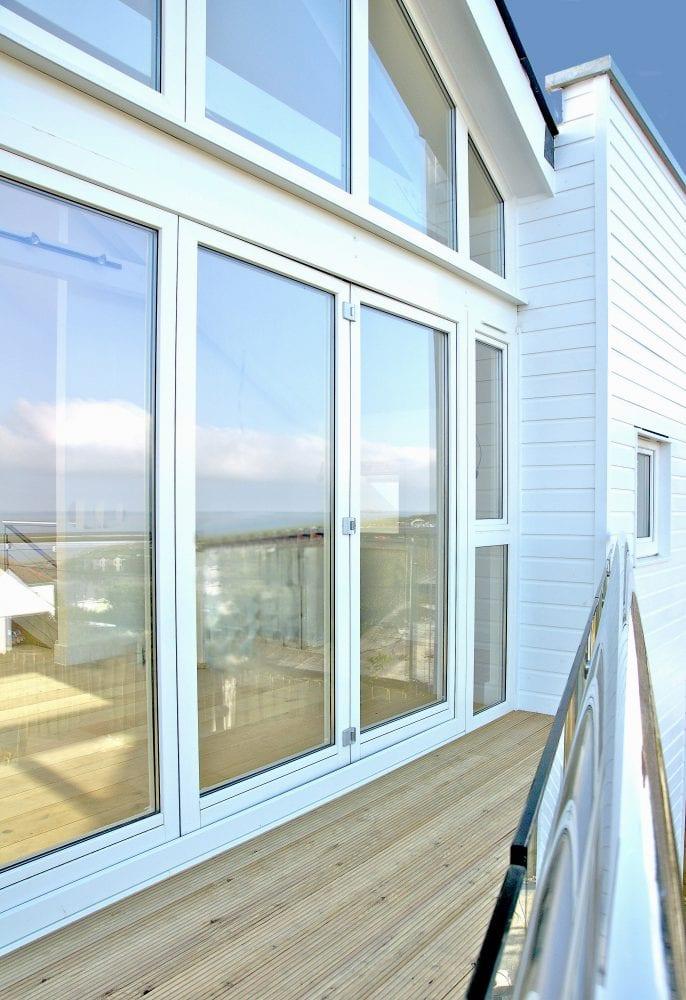 Pvcu Windows And Bi Folding Door With Gable End Frames Overlooking Polzeath Beach Aspect Windows