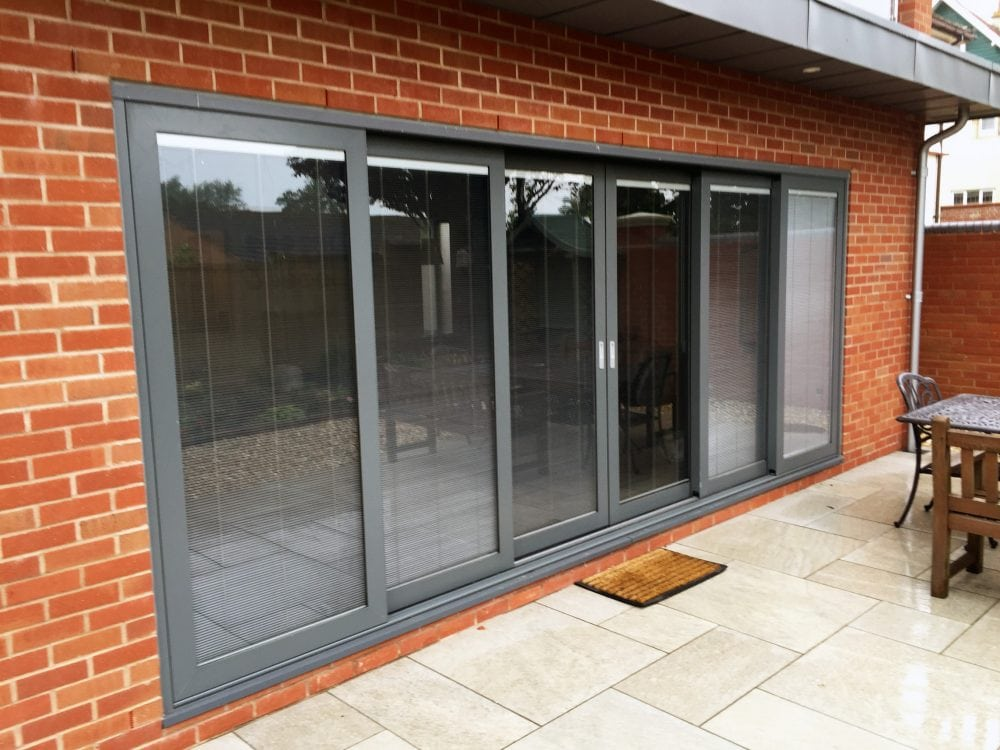 Triple Track Aluminium Lift And Slide Doors In Basalt Grey