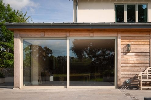 Large glazed lift and slide doors