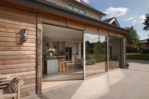 Opening the kitchen to the fantastic garden using large sliding doors