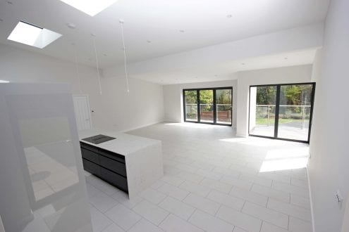Open plan living area with aluminium glazing